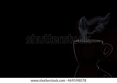 Black cup of coffee with steam isolated on black background