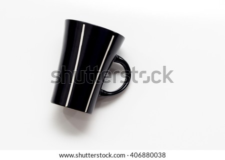 black cup on a white background - stock photo