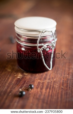 Black currant, blackberry and raspberry jam in a jar - stock photo