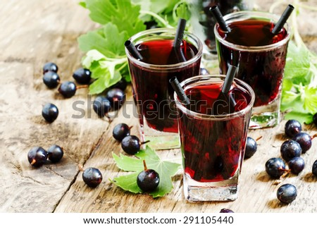 Black currant cocktail with berries, selective focus - stock photo