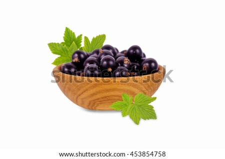 black currant in a wooden bowl. Ripe and tasty currant isolated on white background. - stock photo