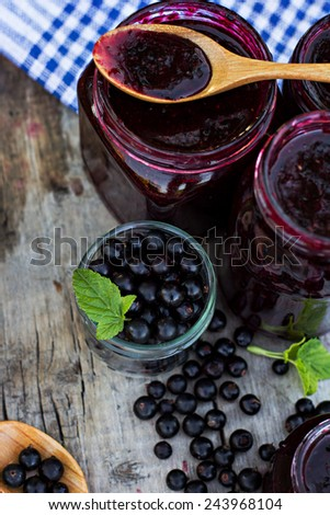 Black currant jam on the old table - stock photo