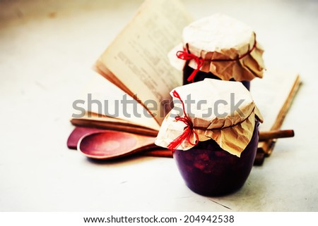 Black currants jam on a old wooden background - stock photo