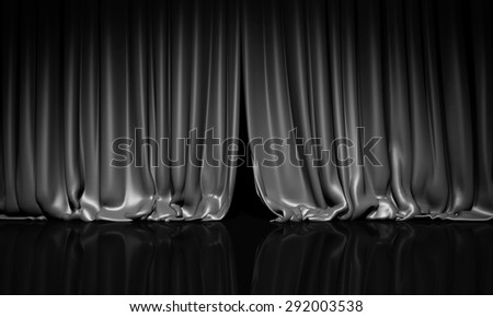 Black curtain with spot light on theater or cinema stage. - stock photo