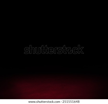 Black dark wall and red floor interior background - stock photo
