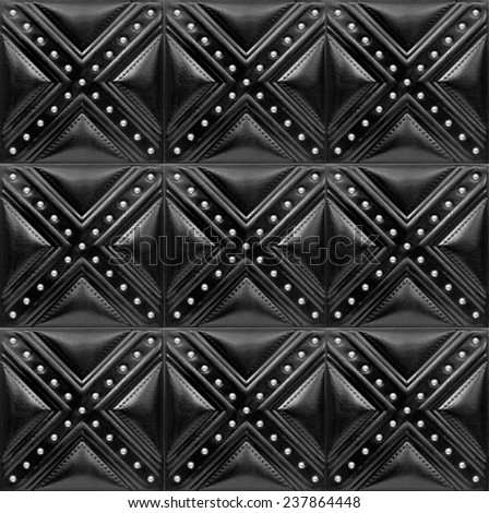 Black Decorative tile with texture of skin and volume drawing, nobody. - stock photo