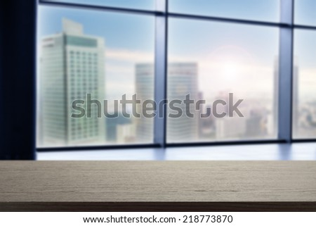 black desk and free space on desk with city landscape  - stock photo