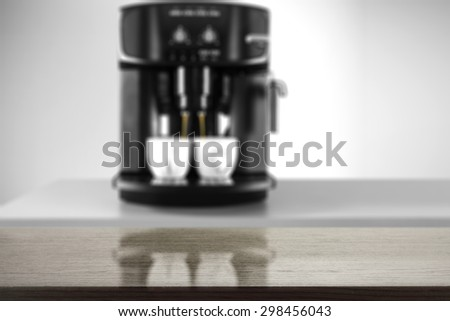 black desk top and black coffee machine