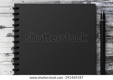 black diary on a wooden table