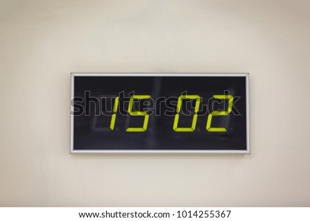 Black digital clock on a white background showing time 15 02