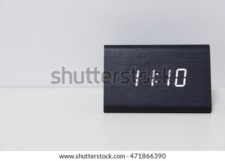 Black digital clock on a white background showing time 11:10 (eleven hours ten minutes)