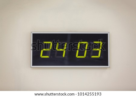 Black digital clock on a white background showing time 24 03 Hour Earth;