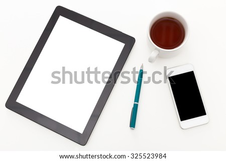 Black digital tablet with blank white screen