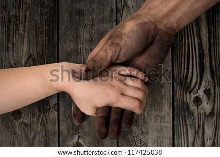 black dirty man hands holding kid clean hand concept