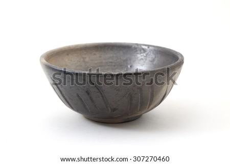 Black dish or crock pot, isolated on white. - stock photo