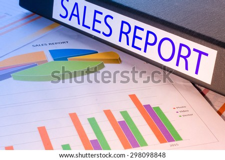 Black document binders with the label sales report - stock photo