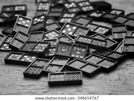 black domino on wooden background -black and white.
