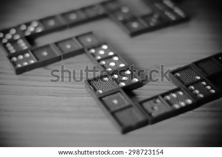 black domino on wooden background black and white color tone style