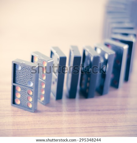 black domino on wooden background vintage style - stock photo