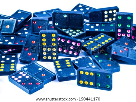 Black domino with colorful dots number on it . - stock photo