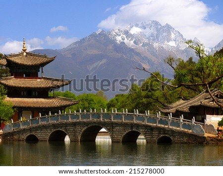 Black Dragon Pool and Jade Dragon Snow mountain (Yulongxui Shan) in Lijiang, Yunnan province of China - stock photo