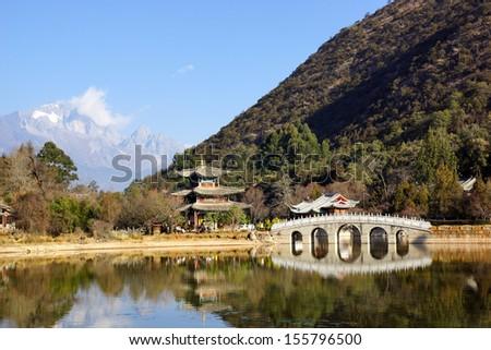 Black Dragon Pool Jade Dragon Snow Mountain in Lijiang, Yunnan, China - stock photo