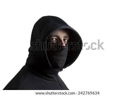Black dressed hooded and masked man isolated on white background - stock photo