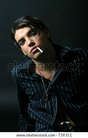 Black dressed model smoking portrait - stock photo