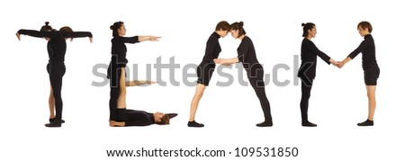 Black dressed people forming TEAM word over white - stock photo