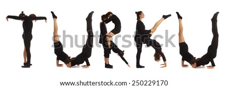 Black dressed people forming TURKU word over white - stock photo