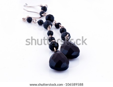 Black earings for the women, isoleted on the white - stock photo