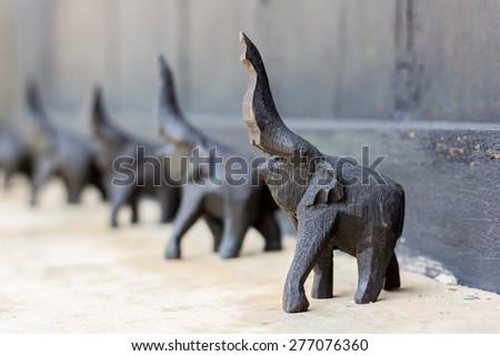 black elephants made from wood - stock photo