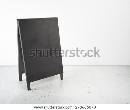 Black empty menu board in interior - stock photo