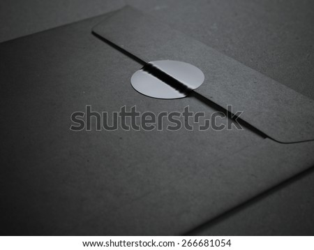 Black envelope with blank sticker - stock photo