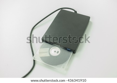 black external usb floppy disk drive with a white disk inside,on white background