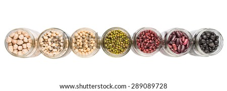 Black eye peas, chickpeas, adzuki beans, mung bean, soy beans, black beans and red kidney beans in mason jars over white background - stock photo