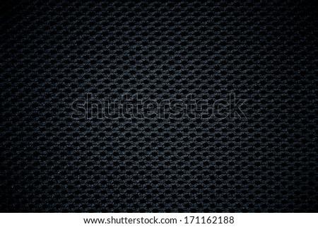 black fabric mesh texture background - stock photo