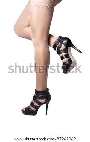 Black female feet sexys summer shoes on a white background - stock photo