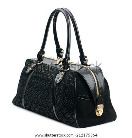 Black female leather bag isolated on white background. - stock photo