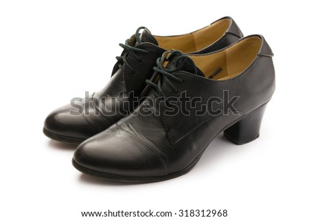 Black female pump leather shoes on white