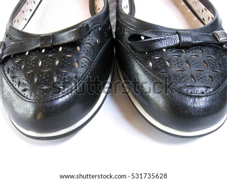 Black female shoes on a white background.