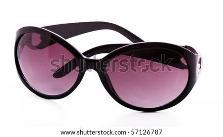 Black feminine sunglasses isolated on white - stock photo
