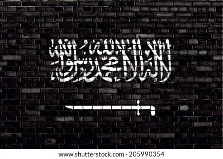 Black flag of Jihad painted on brick wall - stock photo