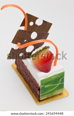 black forest cake decorated with strawberry glazed and chocolate decorations - stock photo