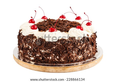 Black forest cake decorated with whipped cream and cherries. Isolated on white background - stock photo