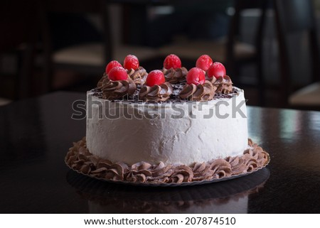 Black forest cake on a wood table  - stock photo