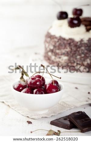 Black forest cake, Schwarzwald pie, dark chocolate and cherry dessert on a white wooden background - stock photo