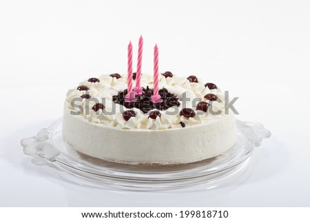 Black forest cake with candles, close-up - stock photo