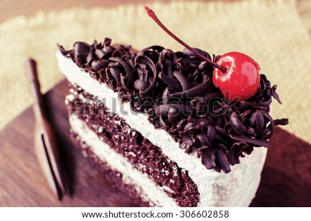 Black Forest, Chocolate cake on wooden table, Vintage tone - stock photo