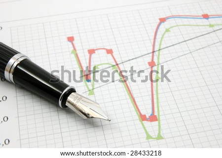black fountain pen on business stock chart
